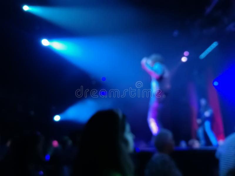 Defocused abstract blurred scene of musical light performance in. A concert on stage with crowd royalty free stock images