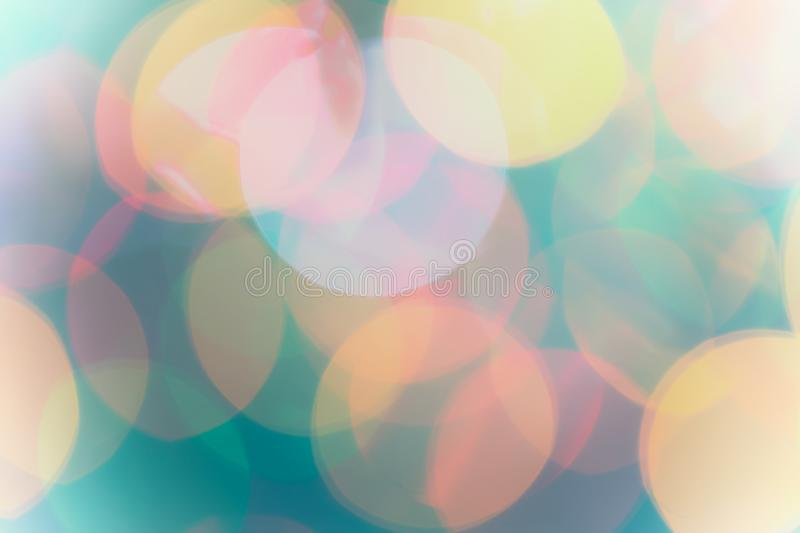 Defocused abstract Christmas light bokeh background in green and stock photography