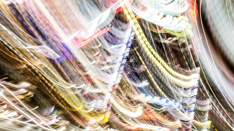 Defocused abstract electro multi colored lights. Festive bright background with gleaming effect and shiny bright neon glow stock photo