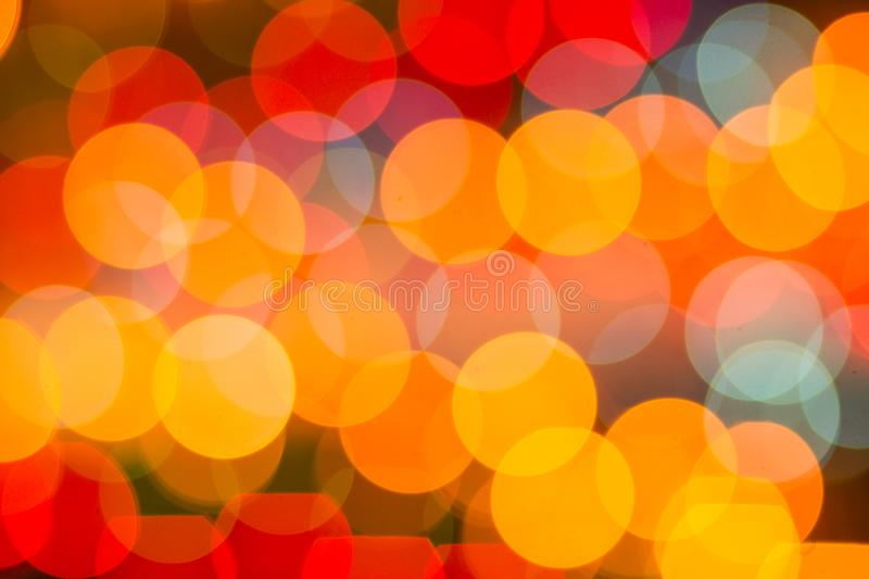 Defocused abstract red and yellow christmas background. Bokeh stock photos