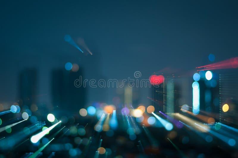 Defocused abstrakcjonistyczna miasto noc zaświeca tło obraz stock