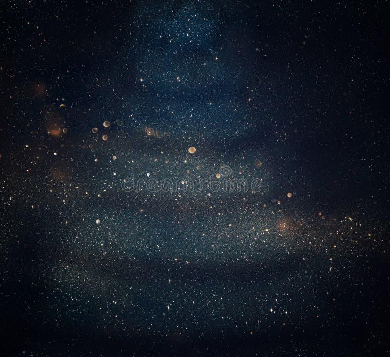 Defocused abstrakt guld- och blåttljusbakgrund arkivbild