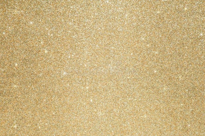 Defocused abstraktes Gold des Funkelnscheingoldhintergrundes beleuchtet auf Hintergrund lizenzfreie stockbilder
