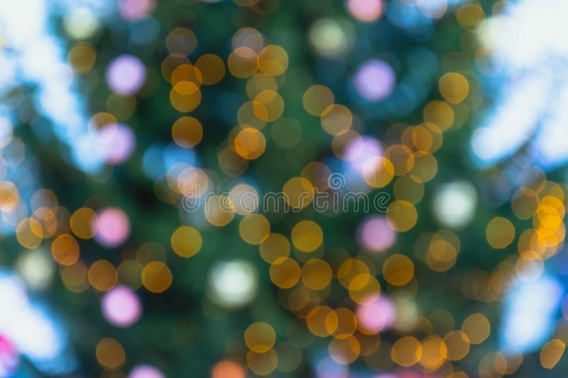 Defocused background of christmas tree and christmas lights and decorations stock photography