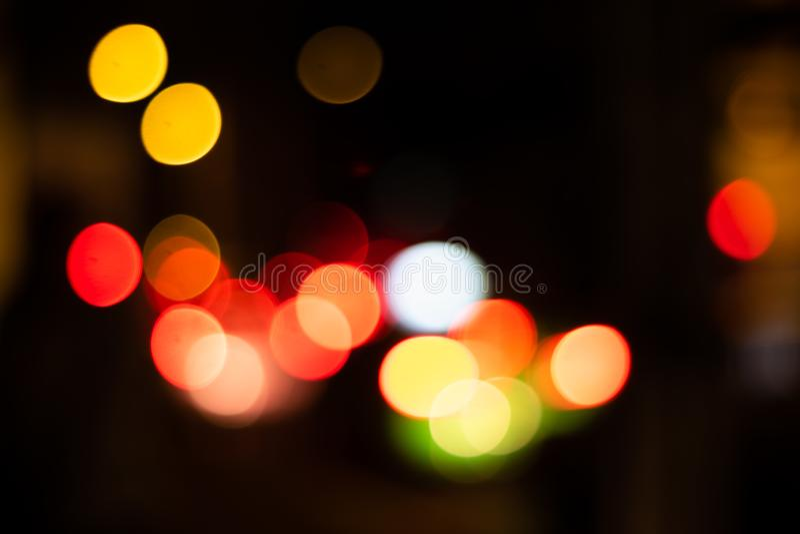 Defocused background in the city. Defocused lights bokeh background in the night city. dark backgroung stock image
