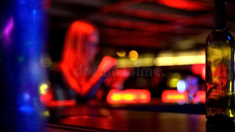 Defocused background of cute woman drinking cocktail at party in nightclub. Stock photo royalty free stock images