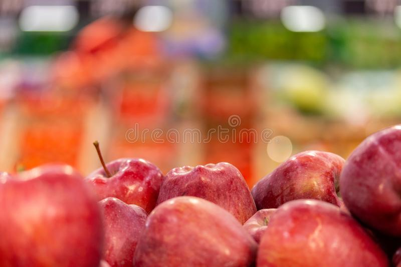 Defocused background, fruit counter with red apples. In the foreground, horizontal royalty free stock photos