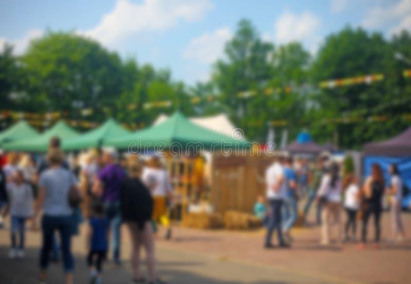 Defocused background of people in park food festival, summer festival stock image