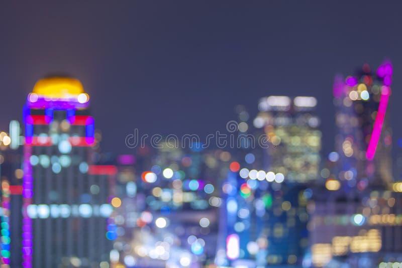 Defocused bakgrund för abstrakt begrepp för stadsnattbokeh royaltyfria bilder
