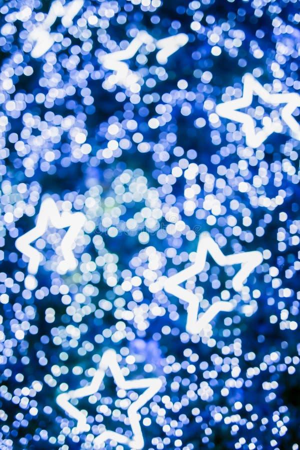 Defocused bokeh и звезда Abstra bokeh тона мерцания светлое теплое стоковое фото rf