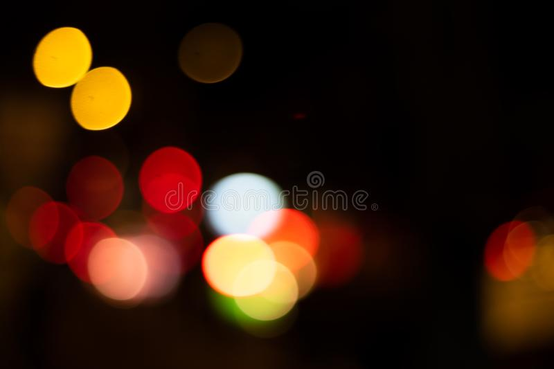 Defocused bokeh background in the city. Defocused lights bokeh background in the night city. dark backgroung stock photography