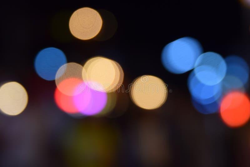 Defocused Bokeh-Feiertage beleuchtet hellen Hintergrund der Hintergrund Zusammenfassungs-Funkeln lizenzfreies stockbild