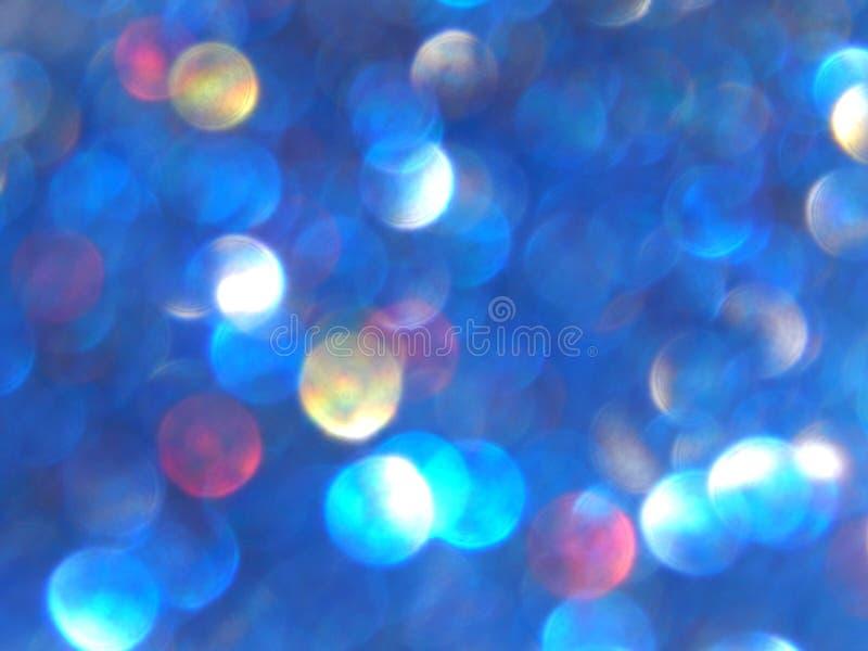Defocused bokeh lichte, blauwe, rode en gele onscherpe fonkelingen, achtergrond stock foto