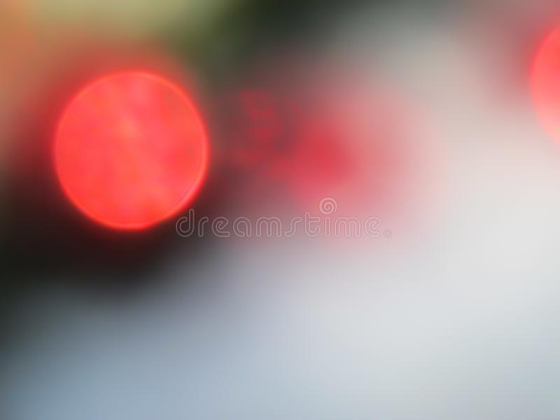 Defocused bokeh lights. Red circles of light. Abstract and Christmas background stock photography