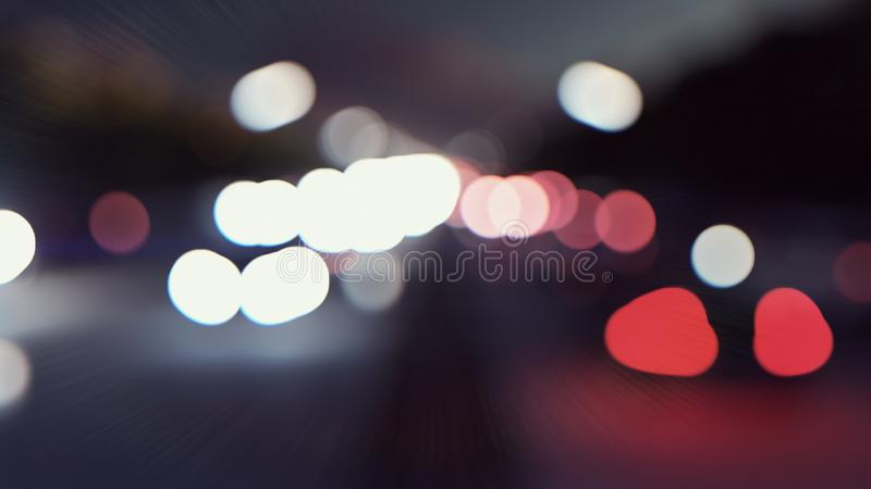 Defocused cars lights and background movement. Cars with lights on go through the city at night. 3D Rendering. Defocused cars lights and background movement royalty free stock image