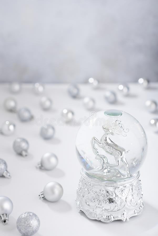 Defocused christmas background with silver christmas water globe and balls. Defocused background with silver christmas water globe and blls royalty free stock photos