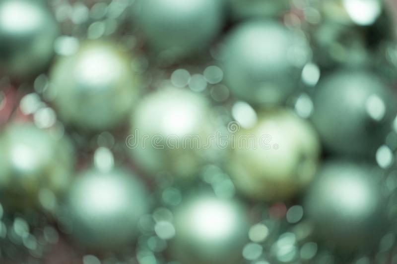 Defocused Christmas composition. Christmas green balls. Blurred abstract background. Christmas composition. Christmas red and pink balls. Blurred abstract royalty free stock images