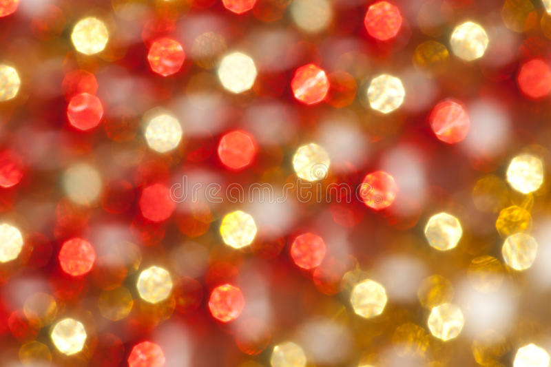 Defocused Christmas Gold and Red Lights stock images