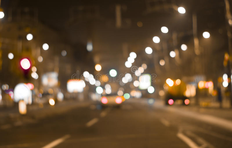 defocused colorful car lights and street lamp bokeh abstract background, blurred city life at night stock photos