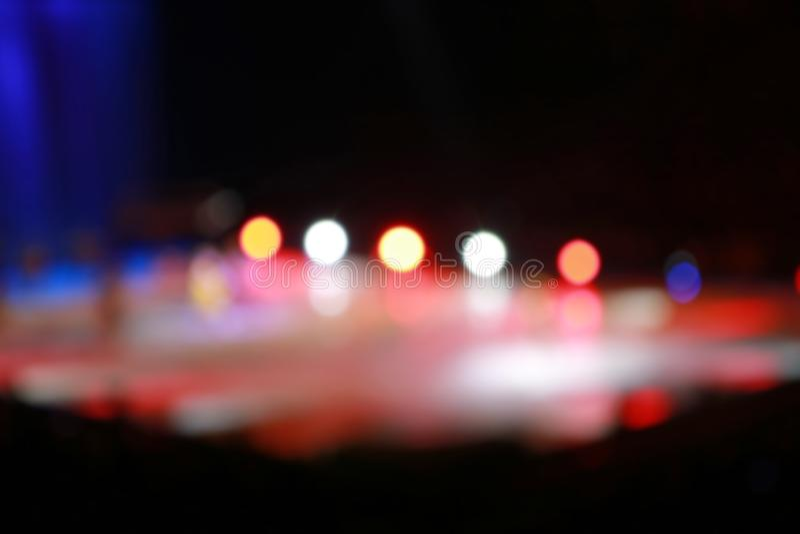Defocused concert lighting on stage stock images