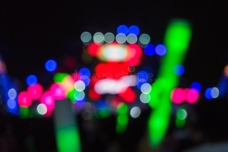 Defocused concert lighting on stage with audience royalty free stock photography