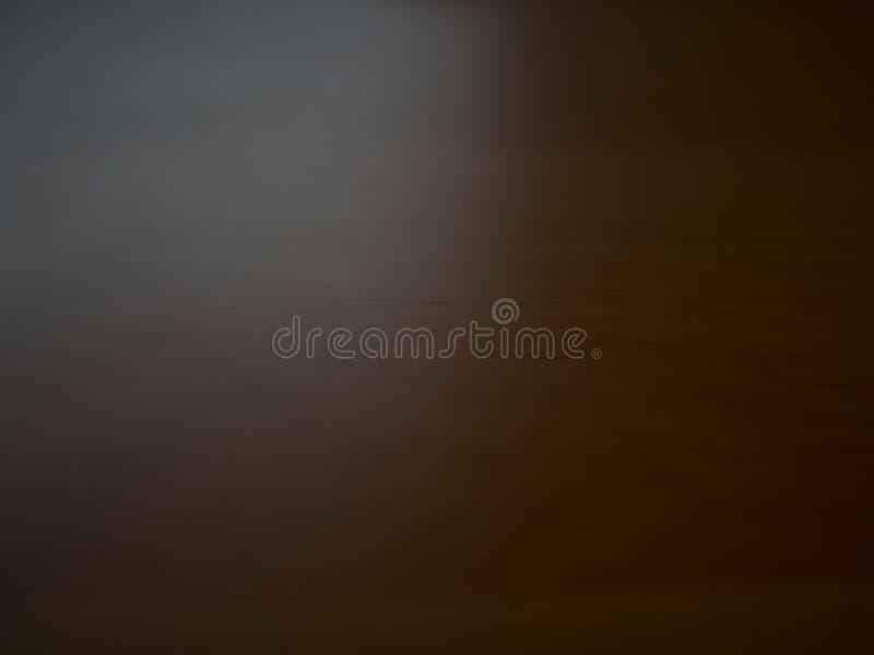 Defocused dunkler und brauner und hölzerner Hintergrund lizenzfreie stockfotos