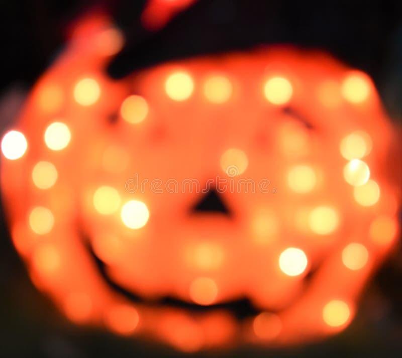 Defocused Dyniowy Pomarańczowych świateł tła teksta Abstrakcjonistyczny Halloweenowy Use Przygotowywający zdjęcia royalty free