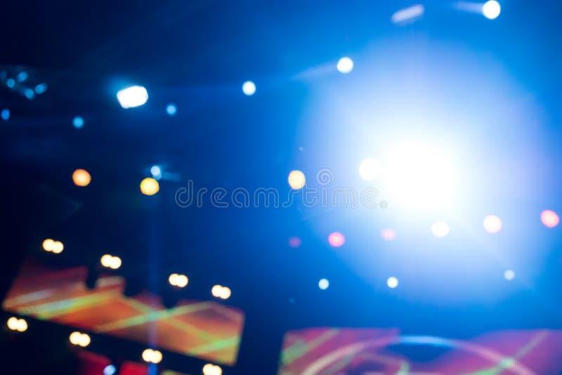 Defocused entertainment concert lighting on stage, bokeh. stock photos