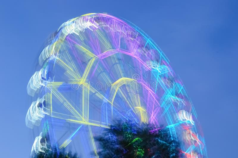 Defocused ferris wheel with colorful lights, Blur abstract background. amusement stock photos