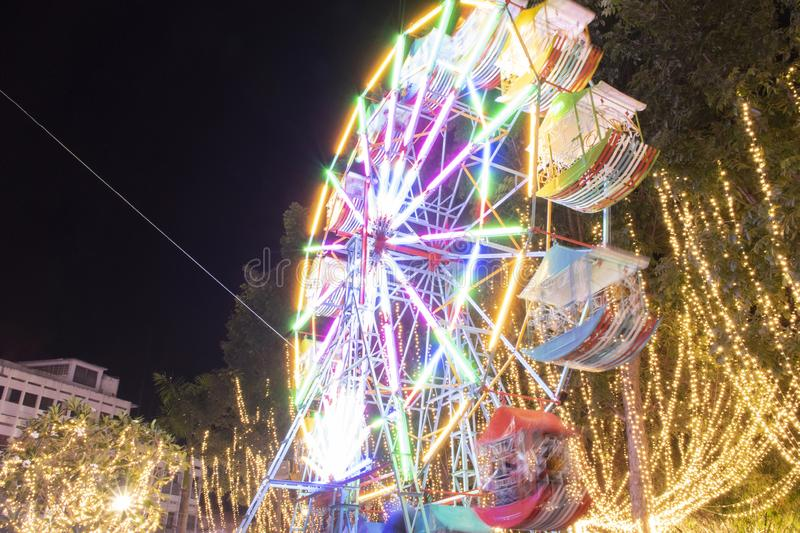 Defocused ferris wheel with colorful lights, Blur abstract background ready for your design. Funny stock photos