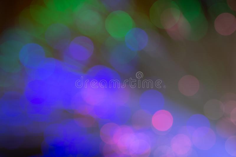 Defocused fiber optics with green, blue and pink bokeh. royalty free stock photography