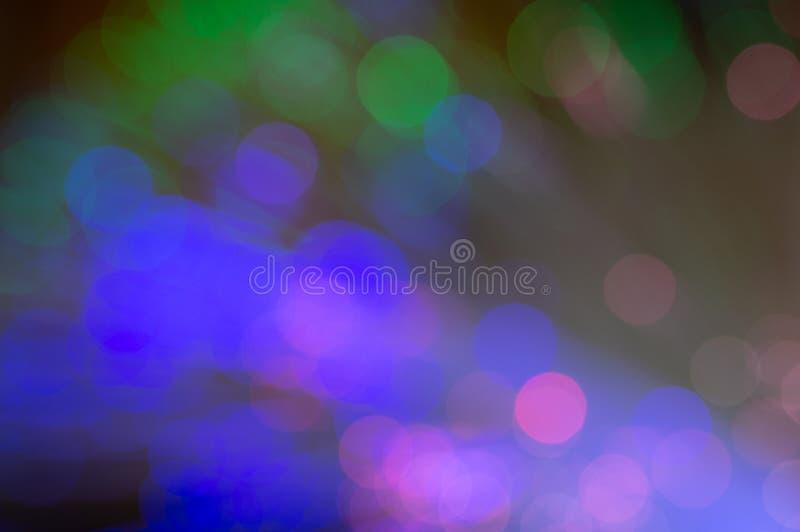 Defocused fiberoptik med gräsplan-, blått- och rosa färgbokeh royaltyfri fotografi