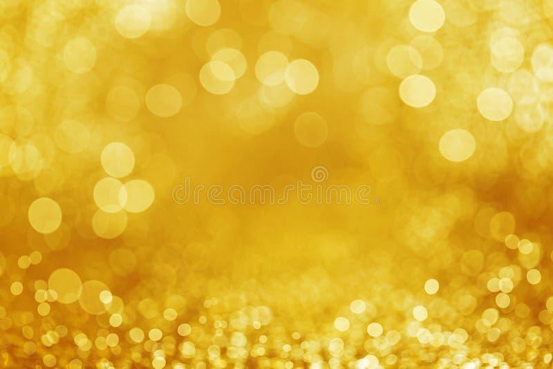 Defocused Hintergrund des Goldfunkelns lizenzfreies stockfoto