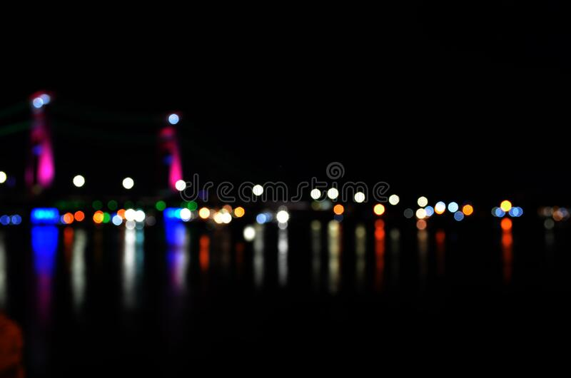 Defocused Image of Illuminated Lights at Night stock image