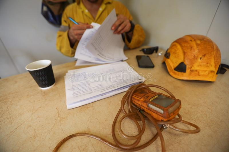 Worker double checking Job Hazard Analysis JHS risk assessment on the table. Defocused isolated construction worker double checking Job Hazard Analysis JHS risk stock images