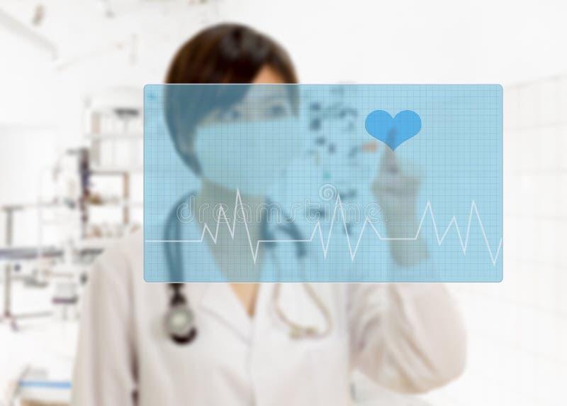 Defocused knoop van het artsen de dringende hart op virtuele interface royalty-vrije stock afbeelding