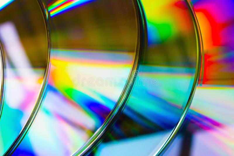 Defocused Licht der abstrakten Hintergrundband-CD-Disketten stockbild
