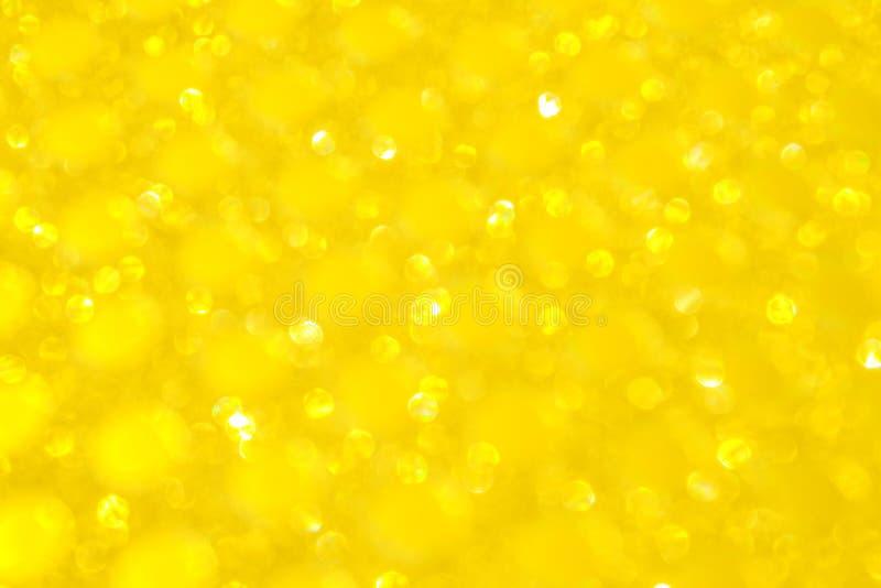 Defocused Lichter Bokeh Funkelnder gelber goldener abstrakter Hintergrund oder Beschaffenheit lizenzfreies stockfoto