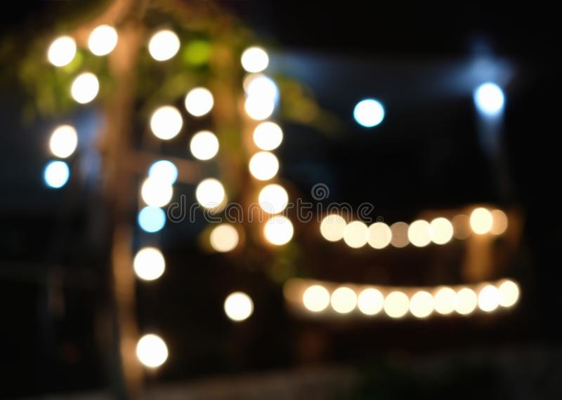 Defocused light decorated on woods in front of house royalty free stock photos