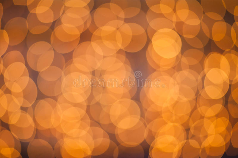 Defocused light dots abstract background. Blurred bokeh sparkles stock images