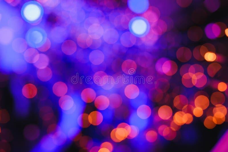 Defocused lights background. Defocused lights. Colored abstract blurred light background. Concept or festival background. Natural background, Twinkly Lights and stock image