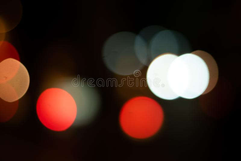 Defocused background on the night city. Defocused lights bokeh background in the night city. dark backgroung stock images