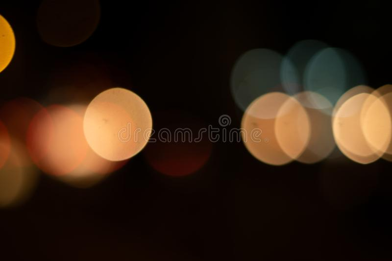 Defocused lights blur background on the night city. Defocused lights bokeh background in the night city. dark backgroung stock photos