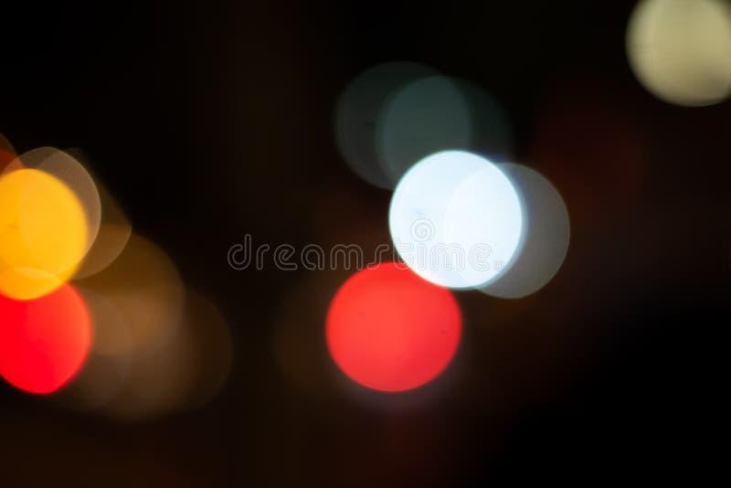 Defocused lights bokeh blur background. Defocused lights bokeh background in the night city. dark backgroung stock image
