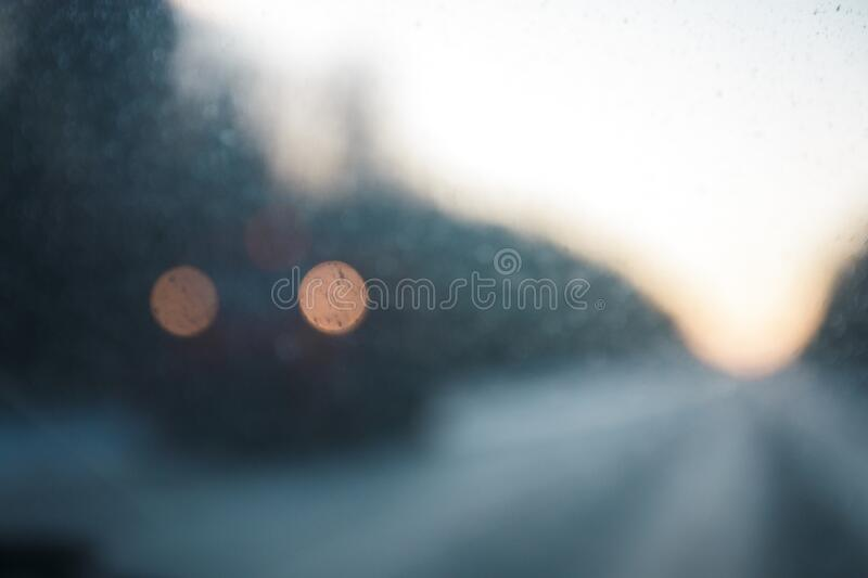 Defocused lights of a car coming in front royalty free stock photo