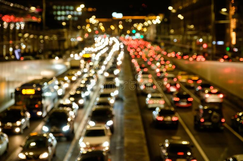 Defocused lights car traffic jam of a street road at night retro color effect for background royalty free stock photography