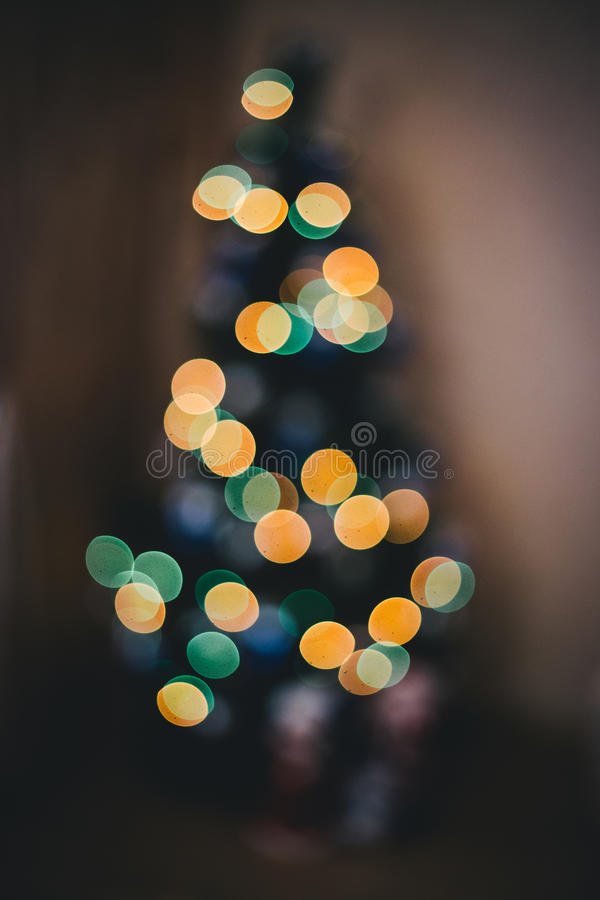 Defocused ligths of Christmas tree. In the house royalty free stock photos