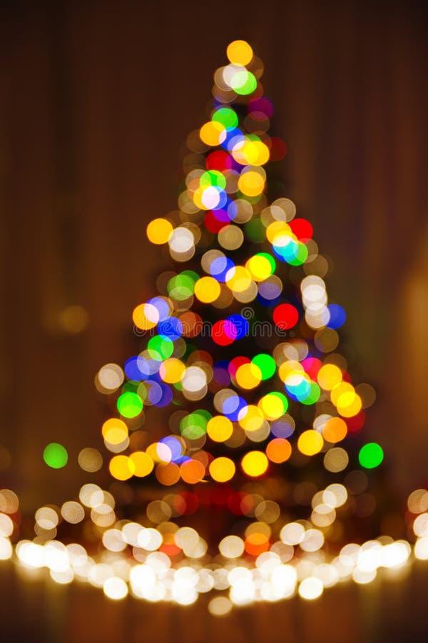 Defocused ljus för jul, Xmas-träd, suddigt ferieabstrakt begrepp royaltyfri fotografi