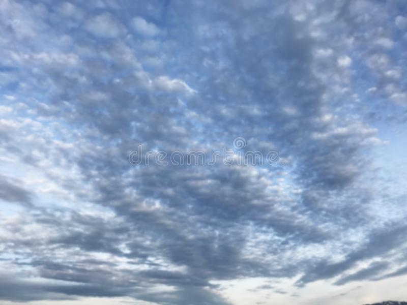 Defocused natural blue cloudscape landscape, cirrocumulus cloud form or pattern in bright day morning or afternoon sky background. royalty free stock images