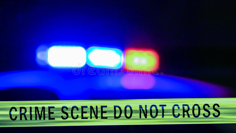 Defocused police car siren with boundary tape royalty free stock photos